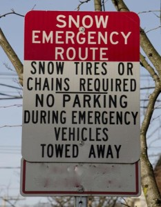 Signs like these mark the snow emergency routes downtown.